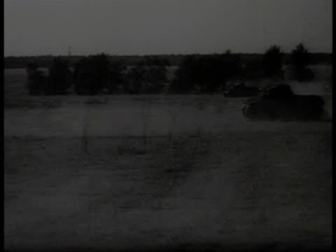 german nazi tanks moving firing on field light tanks moving on street in town ha td german nazi soldiers walking in threes on street edge ws behind... - 1940 stock-videos und b-roll-filmmaterial