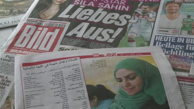 German newspapers Bild and BZ publish a pull out guide in Arabic for refugees in the capital city headlining it Welcome to Berlin