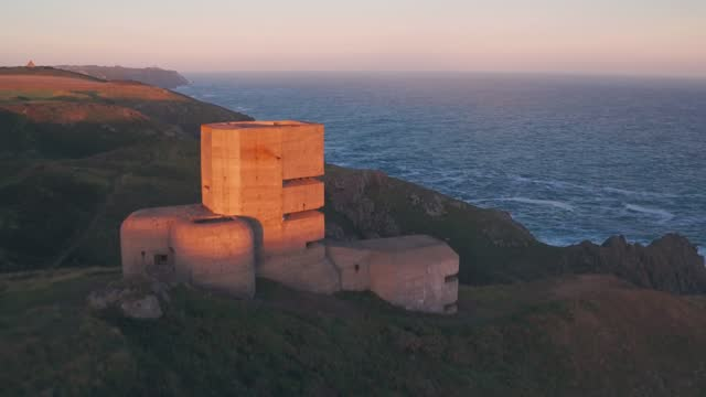 german observation tower from world war two at sunset, guernsey, channel islands, uk. aerial drone view - channel islands england stock videos & royalty-free footage