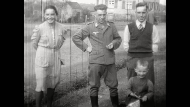 german officer on furlough soldier at his home in plauen family is posing with him for the camera soldier is smoking a cigaret soldier and familiy... - wehrmacht stock videos & royalty-free footage