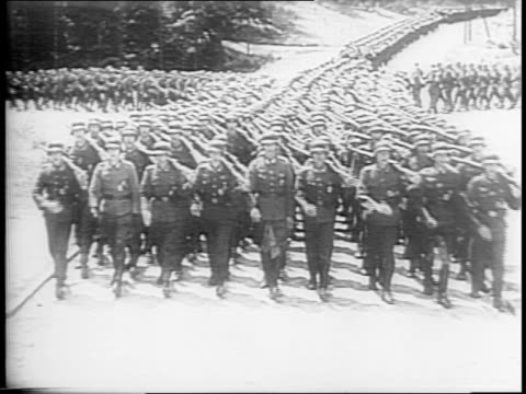 german officers inspecting a line of troops / officer pats young soldier on the face / soldier who pins a medal on another / young smiling nazi... - face down stock videos & royalty-free footage