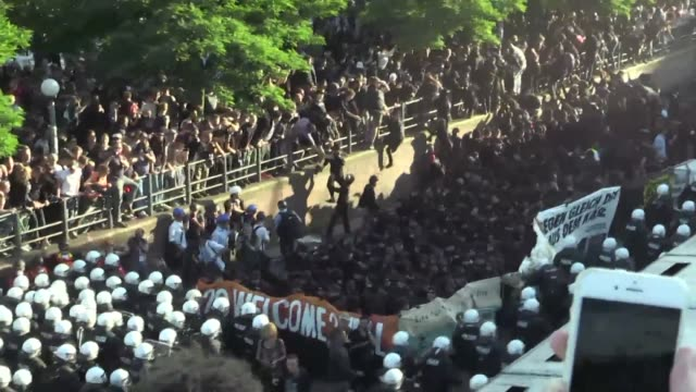german police and protestors clash at an anti-g20 march in hamburg with police using water cannon and tear gas to clear a hardcore of masked... - water cannon stock videos & royalty-free footage