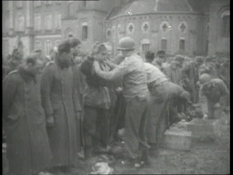 german pows being patted down by american troops and walking / germany - deutsches militär stock-videos und b-roll-filmmaterial