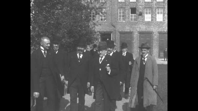 german president friedrich ebert walks with large group of men toward camera / rear view of ebert getting into open top car / note: exact month/day... - helgoland stock videos & royalty-free footage