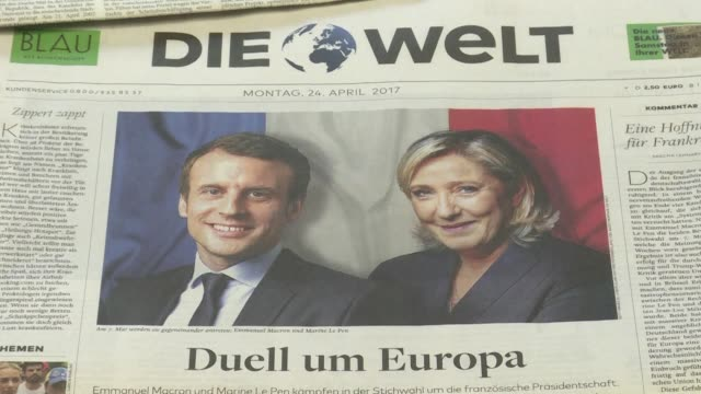 german press react to the first round of the french presidential election that saw centrist emmanuel macron and far-right leader marine le pen go... - runoff election stock videos & royalty-free footage