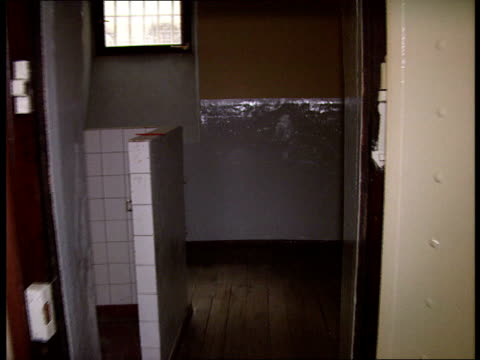 16 Bremen 2730 Exterior GVs former remand prison INT Tracking shot along empty corridor Staircase Empty cell Door closed and opened GVs empty cell...