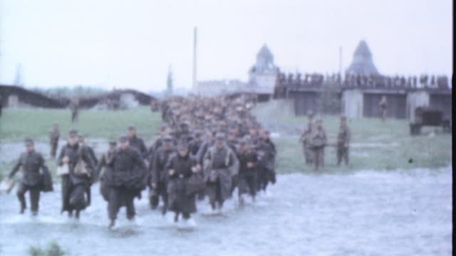 german prisoners being marched across a shallow river by u.s. army soldiers / leipzig, saxony, germany - saxony stock videos & royalty-free footage