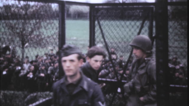 WS German prisoners entering PW cage as US Army soldier looks on / Leipzig Saxony Germany