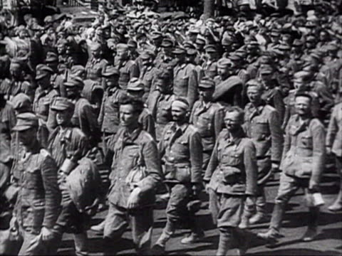 german prisoners walking in column on road audio / russia - 1944 stock-videos und b-roll-filmmaterial
