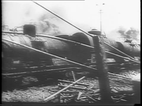 german railroad train speeding down the tracks as seen from a plane / p38 fighter planes diving for an attack / machine gun on plane wing firing /... - railway track stock videos & royalty-free footage