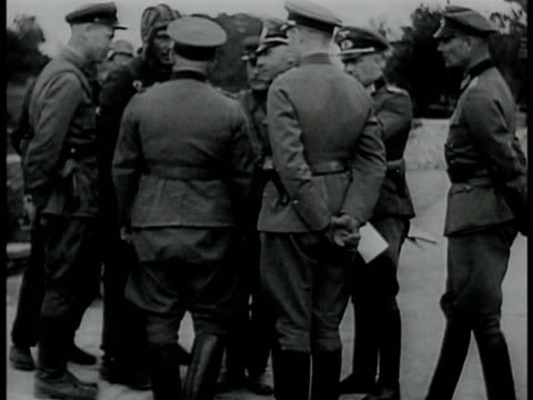 german russian officers soldiers talking in huddle looking at paper soldiers walking through town in rubbles ws nazi soldiers marching through parade... - poland stock videos & royalty-free footage
