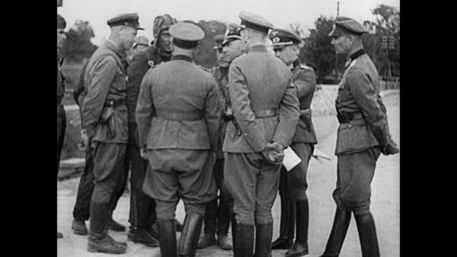 german russian officers soldiers talking in huddle looking at paper soldiers walking through town in rubbles ws nazi soldiers marching through parade... - military invasion stock videos and b-roll footage
