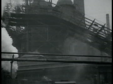 german saar steel mills working smoke stacks standing in fog train station load area molten steel being poured into vat w/ sparks flying. - steel stock videos & royalty-free footage