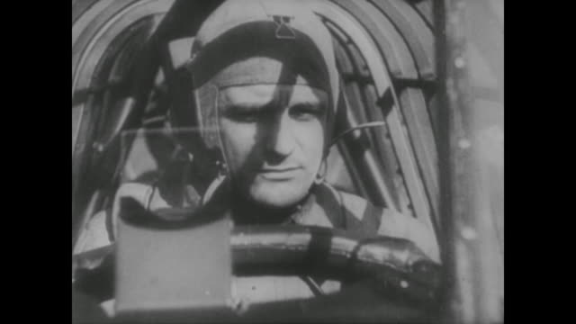 wwii german soldier in plane hovers above a british ship before dive bombing the vessel - wehrmacht stock-videos und b-roll-filmmaterial