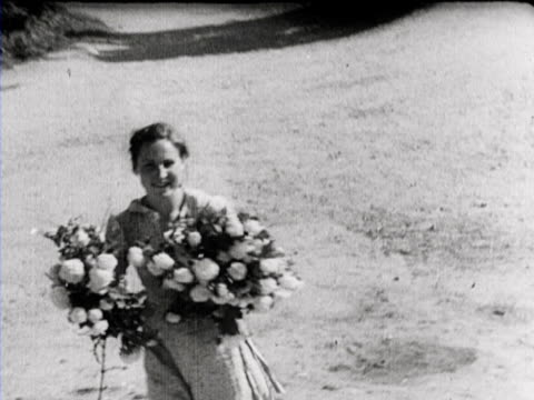 german soldiers arrive in wilna where they receive flowers from children and women a soldier draws with a piece of chalk 'ss' on the wing of an... - lithuania stock videos & royalty-free footage