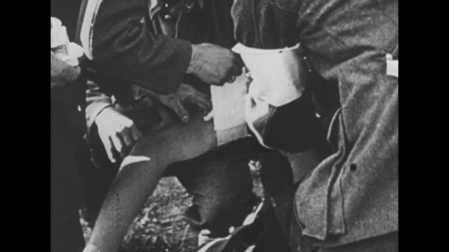 german soldiers carrying wounded soldier on stretcher / close shot of soldiers putting bandage on wounded soldier's arm / close shot of hands... - russia stock videos & royalty-free footage