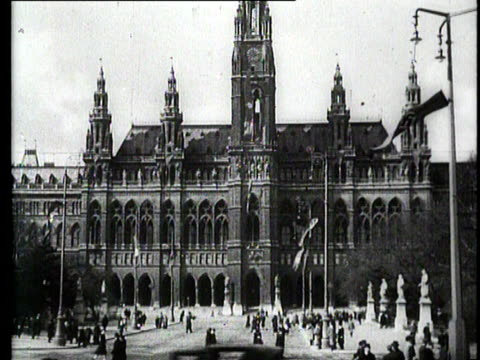german soldiers enter vienna and they are welcomed by a crowd of people hitler enters the city standing in an open car and is also welcomed... - austria video stock e b–roll
