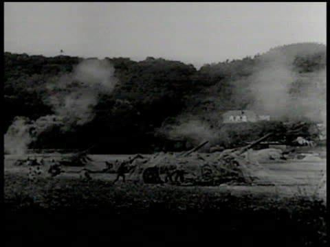 german soldiers firing artillery barrage on field. burning building, fire. french soldiers on top of bunkers, maginot line. maginot line casemates. - 1939 stock videos & royalty-free footage