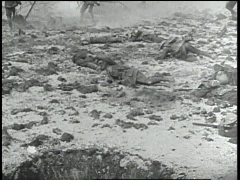 german soldiers firing machine gun / wounded soldier throws grenade collapsing - machine gun stock videos & royalty-free footage