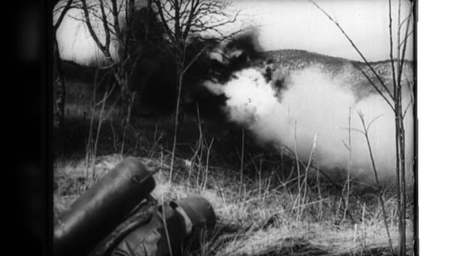 german soldiers in france fire mortar shells and practice destroying trenches and pillboxes with flamethrowers and detonating powder during world war... - war stock-videos und b-roll-filmmaterial