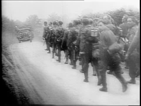 german soldiers in trenches / soldiers marching taking cover / allied planes overhead / soldiers riding in motorcycle with sidecar take cover /... - flugabwehr stock-videos und b-roll-filmmaterial