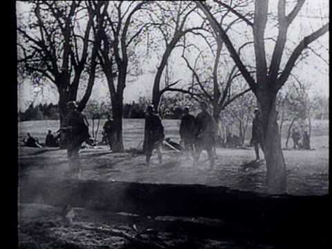 german soldiers inspect a burning farm and arrest one of the residents - 1944 stock-videos und b-roll-filmmaterial
