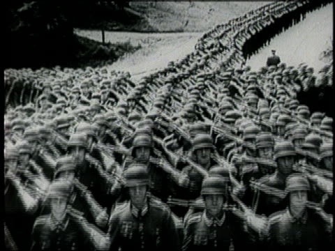 vídeos de stock, filmes e b-roll de german soldiers march as they invade paris, france. - adolf hitler