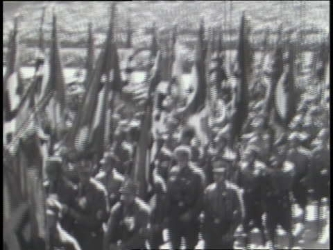 vidéos et rushes de german soldiers march with nazi flags and banners; the italian army carries emblems representing fascism. - seconde guerre mondiale
