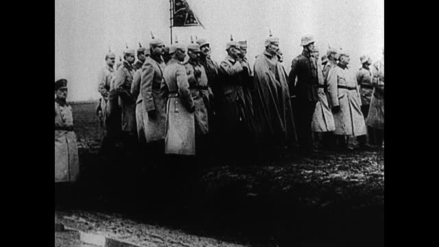 german soldiers marching ws german officers standing ws troops marching ws officials troops standing on field bg wwi invading belgium - erster weltkrieg stock-videos und b-roll-filmmaterial