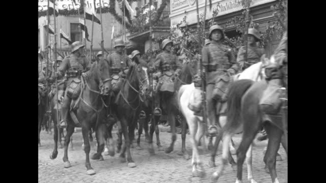 stockvideo's en b-roll-footage met german soldiers marching in formation down street of oppeln silesia / german cavalry riding in formation down street / trucks carrying soldiers... - versailles
