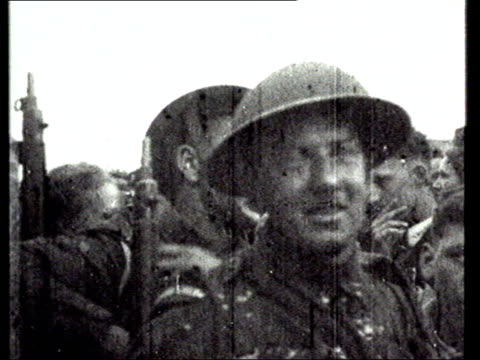 all free channel archive for use on itv only**** german soldiers marching through streets channel islanders with liberation forces force 135 troops... - 英国海峡 チャンネル諸島点の映像素材/bロール