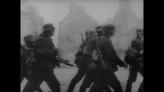 wwii german soldiers sing as they gathers arms weapons vehicles and manpower along the french coast in readyment for the invasion of england - 1940 stock-videos und b-roll-filmmaterial