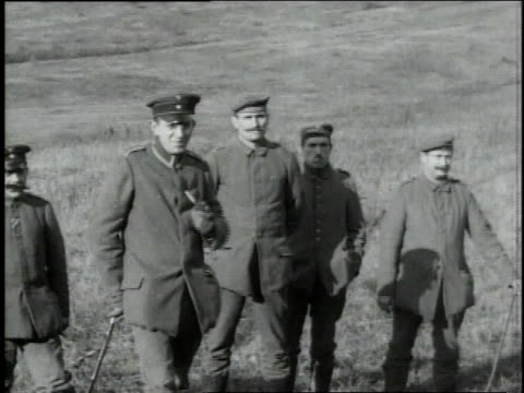 vidéos et rushes de german soldiers standing and waiting one smoking a pipe / - soldat