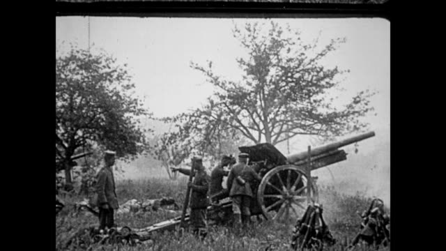 / german soldiers standing in a field with a large cannon style gun / the gun is loaded and fired repeatedly wwi soldiers fire large gun on january... - artiglieria video stock e b–roll