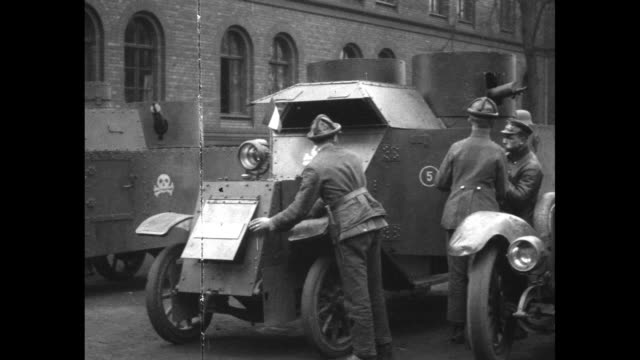 german soldiers standing on berlin street with reichskriegsflagge imperial flag of the revolution flies from truck /ws crowd of civilians on street... - textile patch stock videos & royalty-free footage