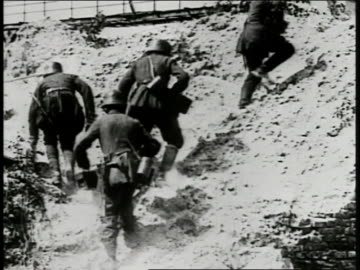 german soldiers walking over rocky hillside. xws multiple explosions in open field, lots of smoke, possibly poison gas from 'white star' shells.... - world war one stock videos & royalty-free footage