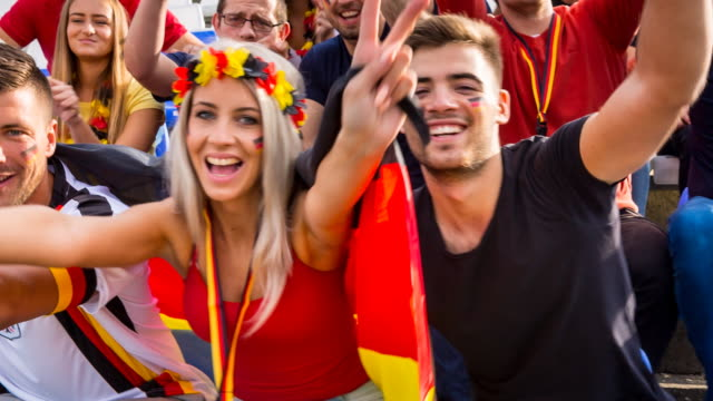 cu german sport fans at soccer stadium, cheering into camera - waving gesture stock videos & royalty-free footage