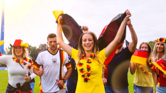 ms german sport fans celebrating at soccer stadium - ファン点の映像素材/bロール