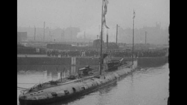 German submarine in Manchester harbor British white ensign and other flags fly atop it US Pres Woodrow Wilson is in Manchester to view the submarine...