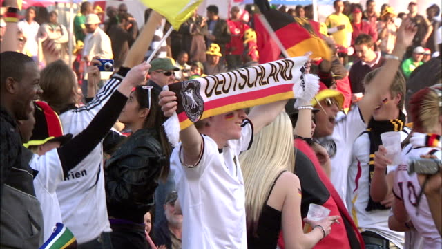 MS German supporters cheering when their team scores at 2010 World Cup / Johannesburg, Gauteng, South Africa