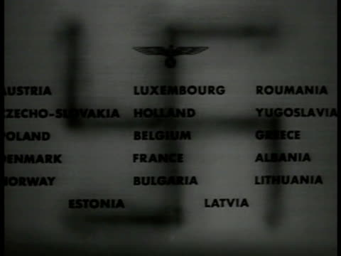 german swastika shadow on paper w/ names of conquered countries - 1940 stock videos & royalty-free footage