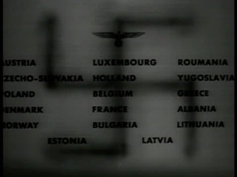 vídeos de stock, filmes e b-roll de german swastika shadow on paper w/ names of conquered countries - 1940