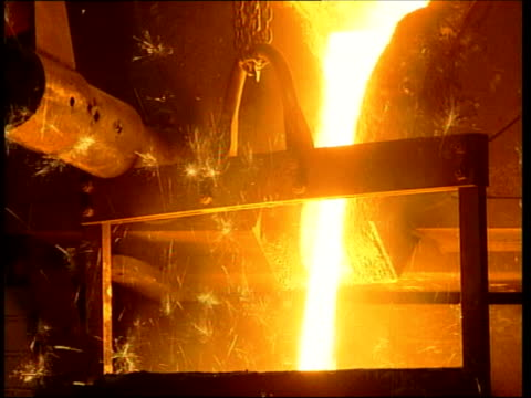 german takeover of industrial gases supplier boc; file / england: int white hot steel being poured from vat into mould in steelworks - vat stock videos & royalty-free footage
