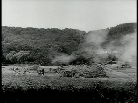 german tank across wooden path ws german soldiers firing artillery cannons vs bomber airplanes in flight int ms bomber soldier taking aim ws field... - nazi germany stock videos and b-roll footage