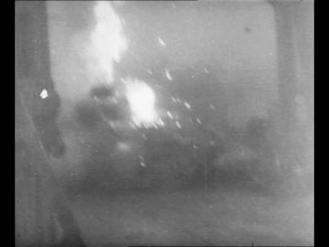 german tank on streets of cologne during world war ii bursts into flames as it is hit by allied tracer bullets soldiers inside get out of turret one... - schutt stock-videos und b-roll-filmmaterial