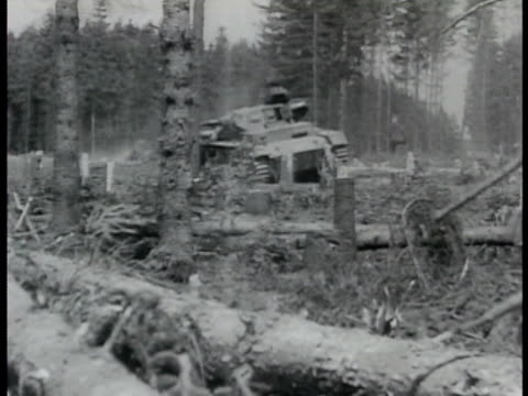 german tank side w/ smoking holes. graphic: german nazi soldiers trying to escape tank soldier shot falling over exit. russian tanks moving in woods.... - tank stock videos & royalty-free footage