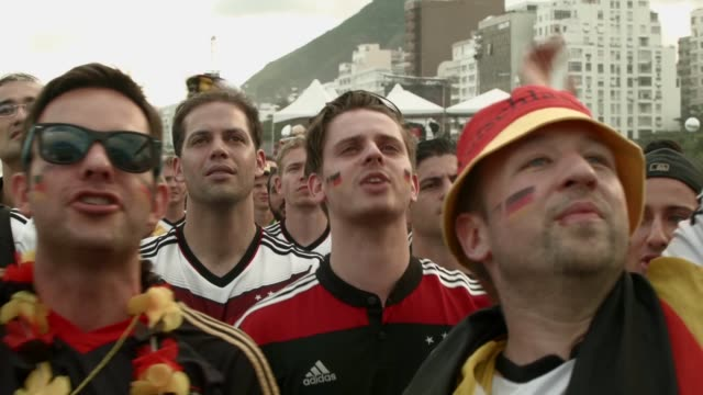 MS German team fans watch their team play against Ghana on the screen setup at the Word Cup FIFA Fan Fest during on Copacabana beach June 21 2014 in...