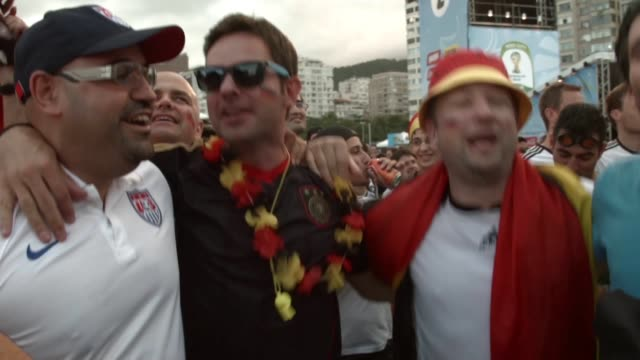 ms german team fans watch their team play against ghana on the screen setup at the word cup fifa fan fest during on copacabana beach june 21 2014 in... - international match stock videos & royalty-free footage