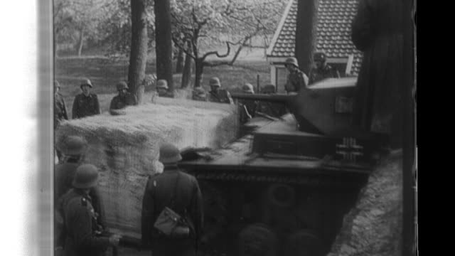 stockvideo's en b-roll-footage met german troops stream into belgium and france with tanks crashing through border fortifications and german artillery directed at paris - pantservoertuig
