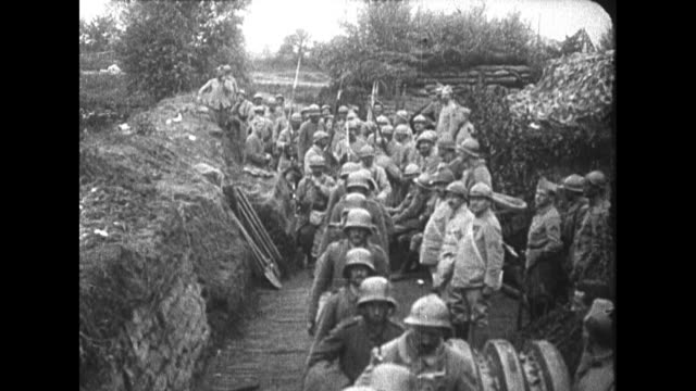 vs german troops walk toward and past camera after being captured by wwi allied forces / ls belgian troops march toward and past camera on the street... - prisoner stock-videos und b-roll-filmmaterial